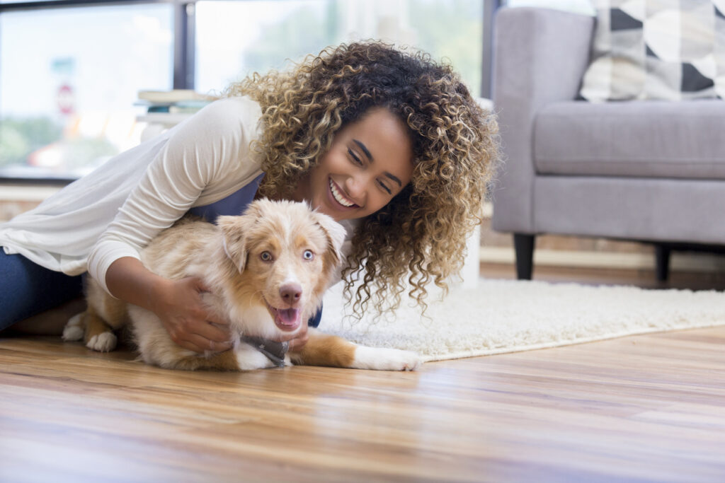 Young woman training puppy
